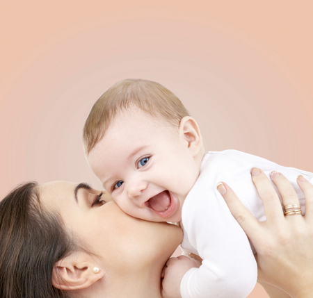 babies laughing: family, child and happiness concept - happy mother with baby