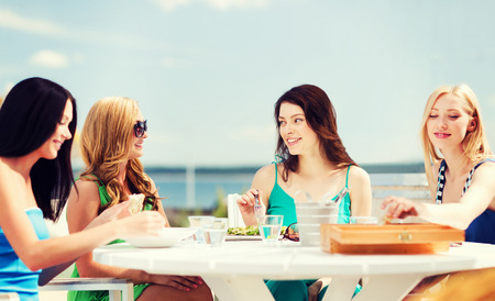 bachelorette party: summer holidays and vacation - girls in cafe on the beach