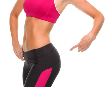 woman buttocks: fitness and diet concept - close up of sporty woman pointing at her buttocks Stock Photo