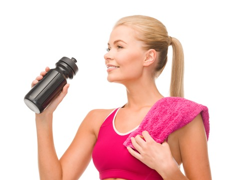 fitness and diet concept - sporty woman with special sportsman bottle and towel photo