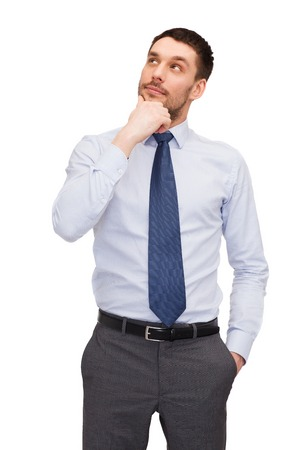 latin man: business and office concept - handsome buisnessman looking up Stock Photo