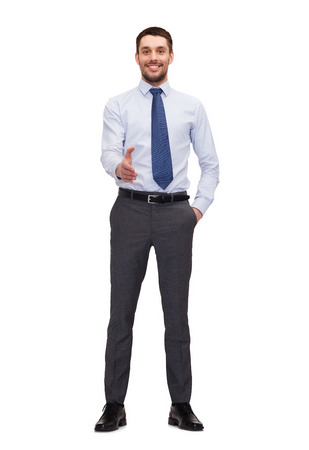 young office workers: business and office concept - handsome buisnessman with open hand ready for handshake