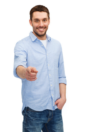 happiness and people concept - smiling man pointing finger at you Stock Photo