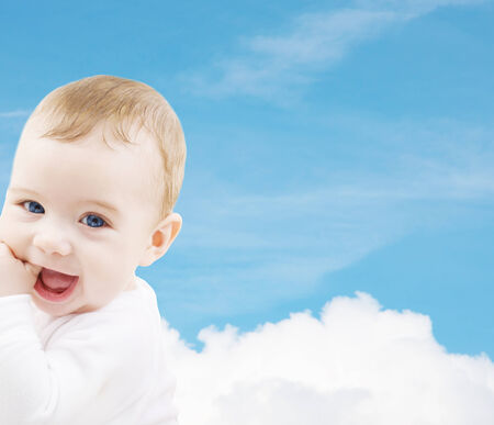 child, people and happiness concept - adorable baby boy photo
