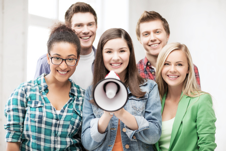 education concept - group of students with megaphone at school photo