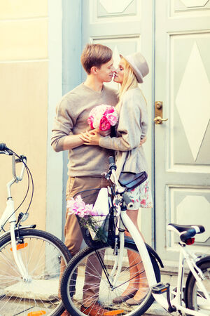 love kissing: summer holidays, vacation, bikes, love and relationship concept - couple with bicycles in the city Stock Photo