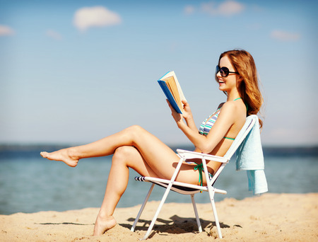 chaise longue: summer holidays and vacation - girl reading book on the beach chair
