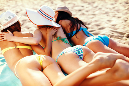 pretty girl: summer holidays and vacation - girls in bikinis sunbathing on the beach