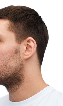 health and body parts concept - close up of male ear photo