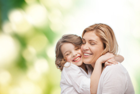pre adult: family, child and happiness concept - hugging mother and daughter