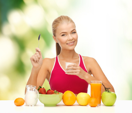 insist: fitness, healthcare and diet concept - smiling young woman eating healthy breakfast Stock Photo