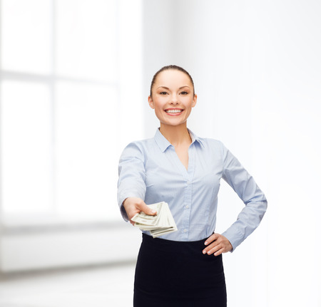 cash money: business and money concept - young businesswoman with dollar cash money Stock Photo