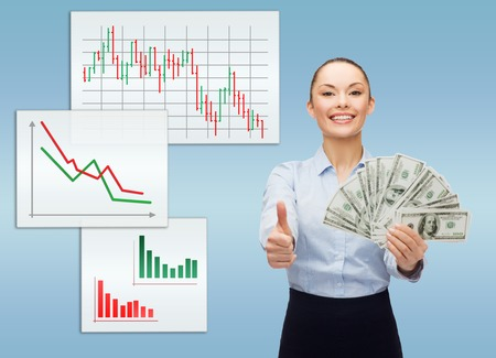 business and money concept - young businesswoman with dollar cash money showing thumbs up