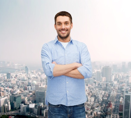 arms crossed: happiness and people concept - smiling man with crossed arms