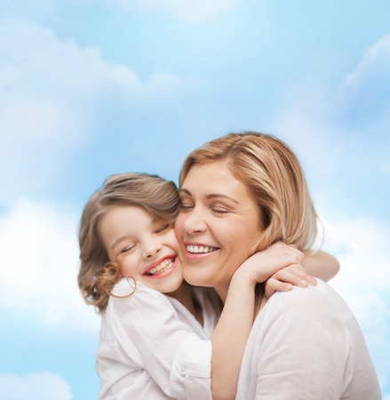 pre teen girls: family, child and happiness concept - hugging mother and daughter
