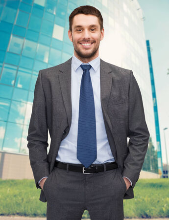 business concept - handsome businessman in suit photo