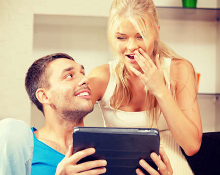 bright picture of happy couple with tablet PC (focus on man) photo
