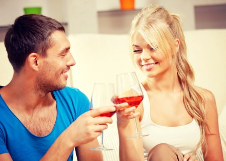 picture of happy romantic couple drinking wine (focus on woman) photo