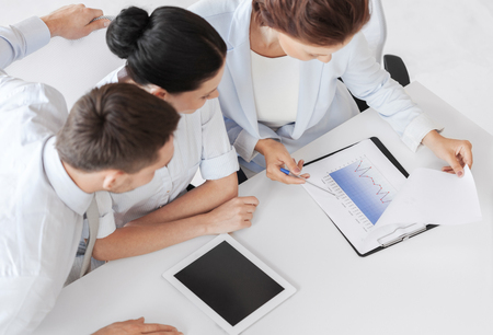 accountancy: business and office concept - business team having discussion in office