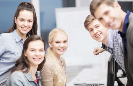 education, school and people concept - group of smiling students having discussion at school photo