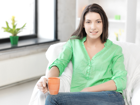 lovely: bright picture of lovely woman with mug Stock Photo
