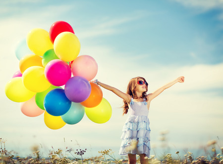 colorful: summer holidays, celebration, family, children and people concept - happy girl with colorful balloons