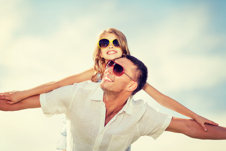 lovely girl: summer holidays, children and people concept - happy father and child in sunglasses over blue sky