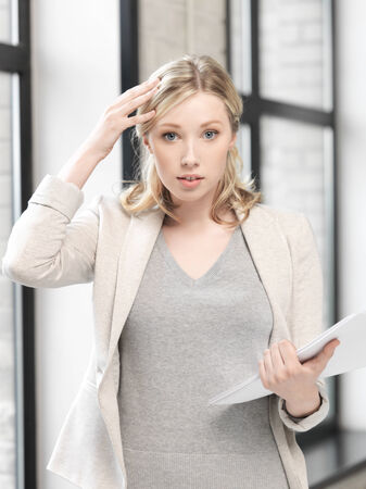 business concept - worried woman with documents photo
