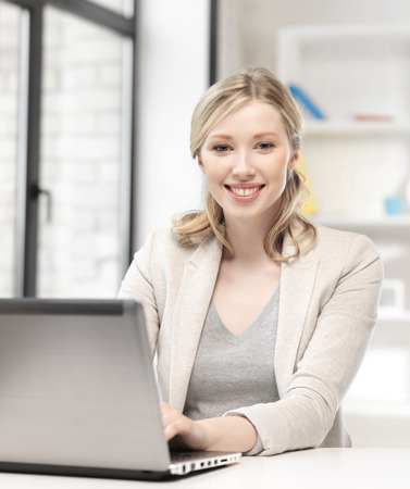 remote access: business and technology concept - happy woman with laptop computer