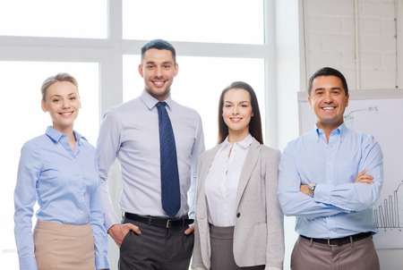young entrepreneurs: business and office concept - happy business team in office