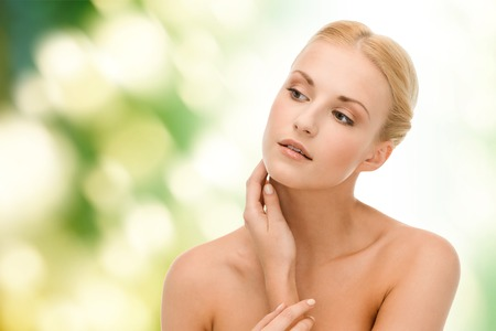 beautiful neck: beauty and spa concept - face of beautiful woman touching her face skin Stock Photo