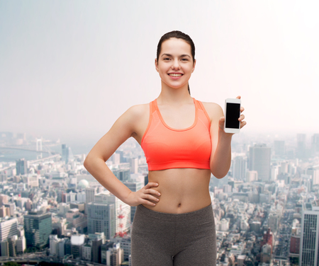 blank center: sport, excercise, technology, internet and healthcare - sporty woman with blank smartphone screen