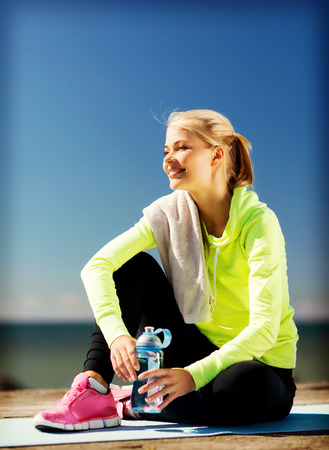 siting: sport and lifestyle concept - woman resting after doing sports outdoors Stock Photo