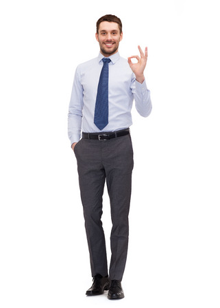 okay sign: business and office concept - handsome businessman showing ok-sign
