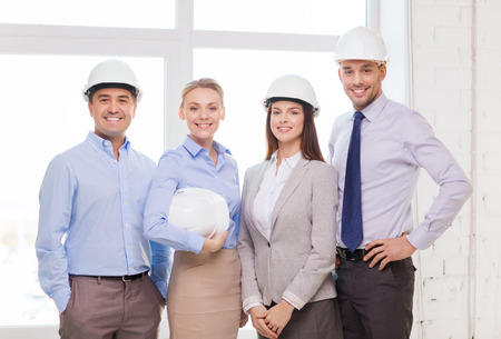 business, architecture and office concept - happy team of architects in office photo