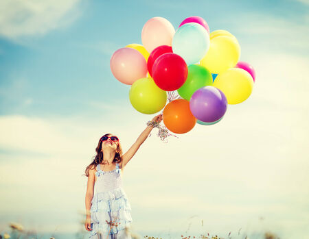 beautiful preteen girl: summer holidays, celebration, family, children and people concept - happy girl with colorful balloons