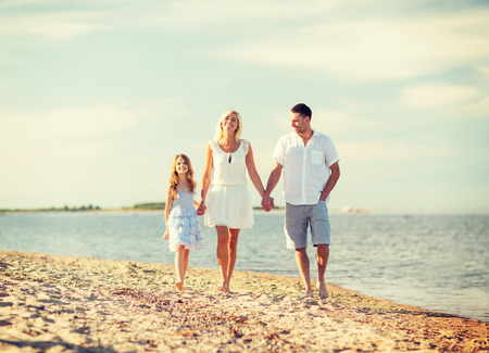 summer holidays, children and people concept - happy family at the seaside photo