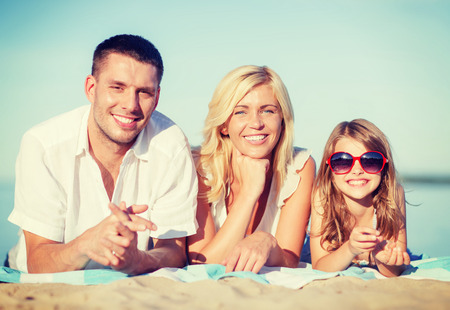 summer holidays, children and people concept - happy family on the beach photo