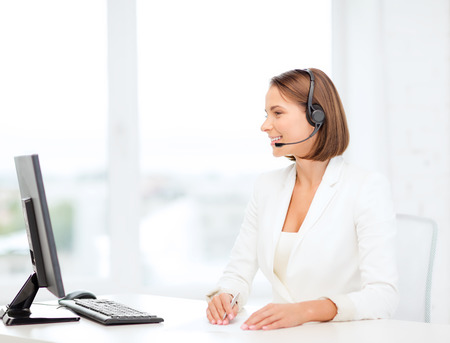 call: business, communication, technology and call center concept - friendly female helpline operator with headphones and computer call center