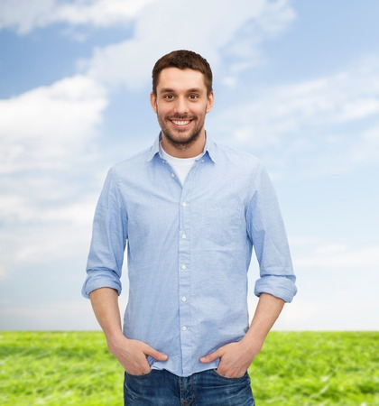 happiness and people concept - smiling man photo