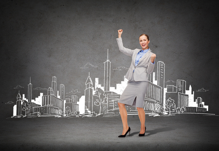 business and office concept - young happy businesswoman with hands up photo