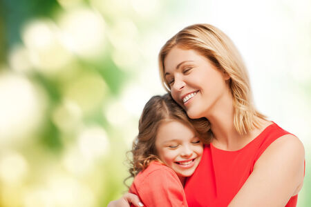 pre teen girl: family, child and happiness concept - hugging mother and daughter