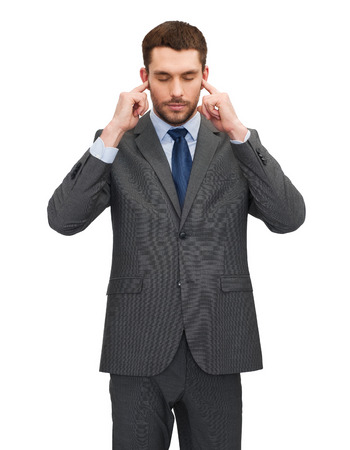 hand covering eye: businss, office and education concept - annoyed businessman covering his ears with his hands