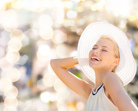 fashion, happiness and lifestyle concept - beautiful woman in hat enjoying summer outdoors photo