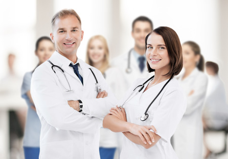 healthcare and medical concept - picture of two young attractive doctors