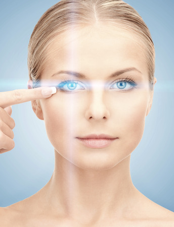 laser focus: health, vision, sight, future technology concept - woman eye with laser correction frame