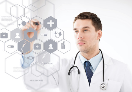 listening device: healthcare, medical and future technology concept - male doctor with stethoscope and virtual screen Stock Photo