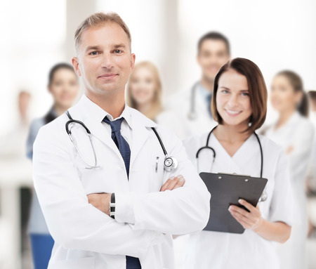 health professionals: healthcare and medical concept - two doctors in hospital Stock Photo