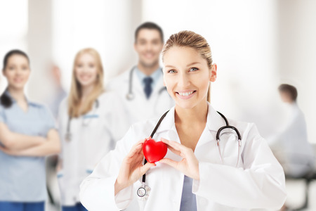 heart doctor: healthcare and medical concept - female doctor with heart