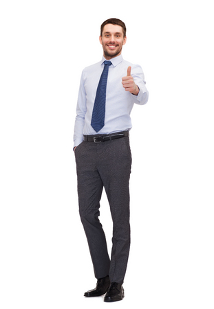 agreeing: business, gesture and office concept - handsome businessman showing thumbs up